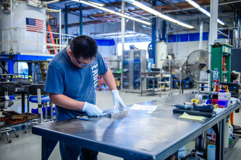Worker prepping fixture for brazing at Altair Technologies USA