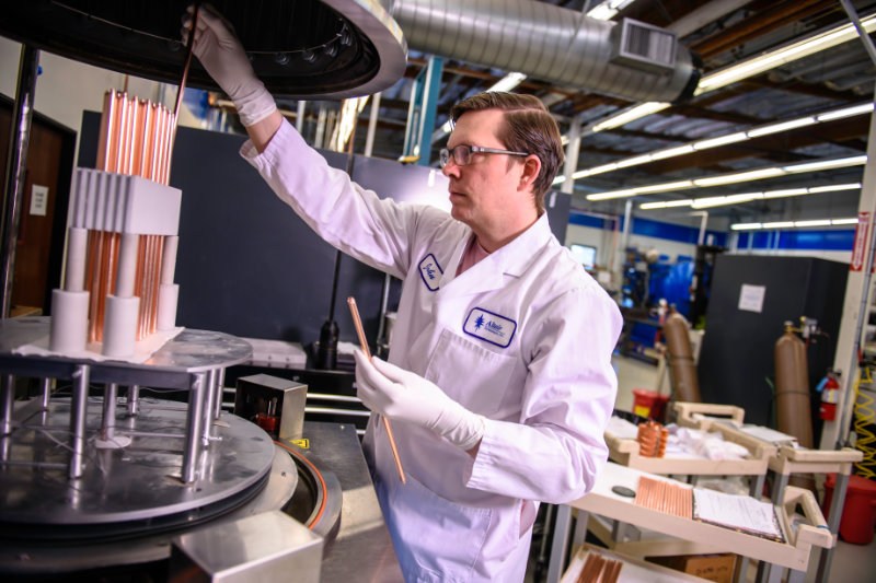 Technician setting-up complex assemblies in a brazing furnace at Altair Technologies