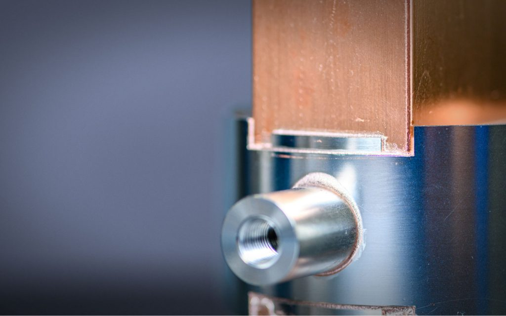 Detail view of brazing copper to stainless steel joints at Altair Technologies, Inc.