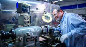 Machinist working on a lathe at Altair Technologies Inc. USA